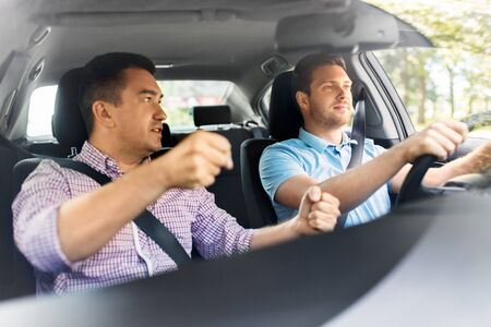 car driving school instructor teaching male driver