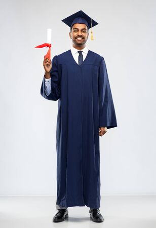 graduate student in mortar board with diploma Stock Photo