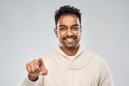 smiling indian man pointing finger to camera Stockfoto
