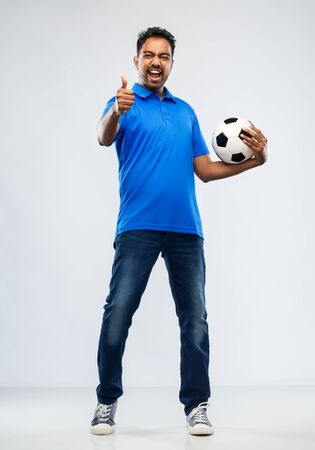 football fan with soccer ball showing thumbs up