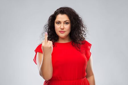 ignorant woman in red dress showing middle finger