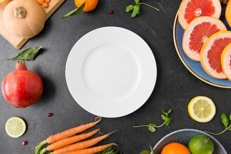 plate, vegetables and fruits on on slate table Stok Fotoğraf - 130587510