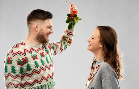 happy couple standing under the mistletoe