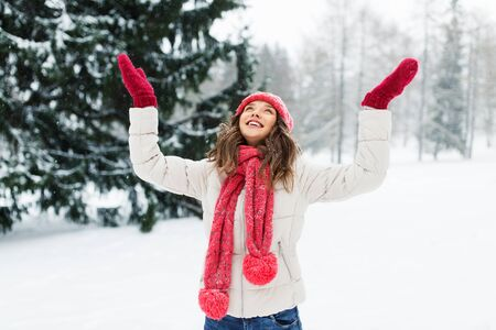 happy young woman in winter park