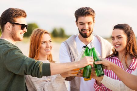friends toasting non alcoholic drinks on beach