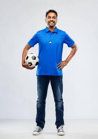indian man or football fan with soccer ball