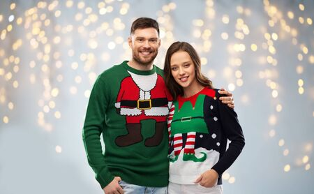 happy couple at christmas ugly sweater party Stockfoto