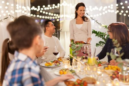 happy family having dinner party at home Stock Photo