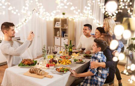 family having dinner party and taking selfie Reklamní fotografie