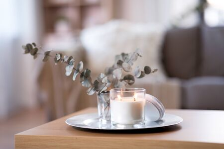 burning fragrance candle on table at cozy home 스톡 콘텐츠