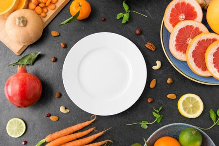 plate, vegetables and fruits on on slate table