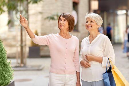 senior women with shopping bags in tallinn city