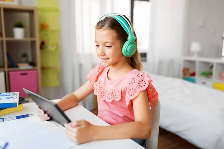 girl in headphones with tablet computer at home Stok Fotoğraf