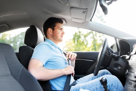 man or car driver fastening seat belt Stockfoto