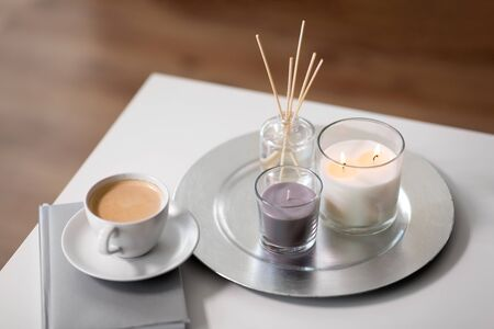 coffee, candles and aroma reed diffuser on table 版權商用圖片