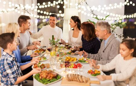 happy family having dinner party at home