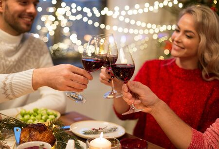 close up of friends with wine celebrate christmas