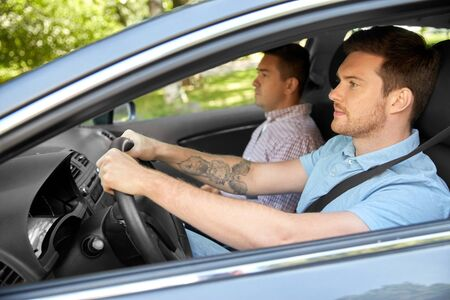 car driving school instructor and male driver Stock Photo