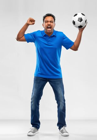 angry indian male football fan with soccer ball