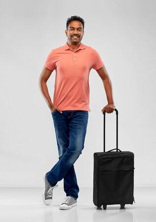 smiling indian man in polo shirt with travel bag Zdjęcie Seryjne
