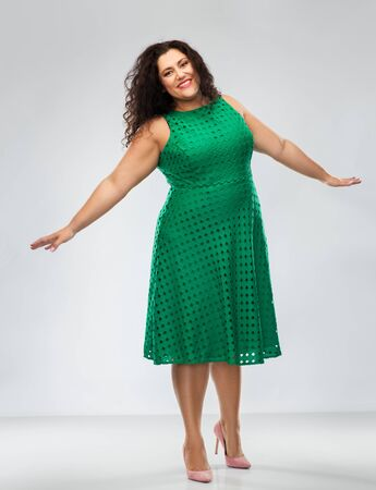 happy woman in green dress over posing
