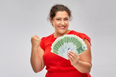 happy woman holding hundreds of money banknotes