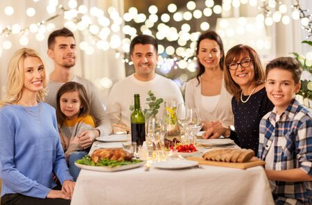 celebration, holidays and people concept - happy family having dinner party at home 写真素材