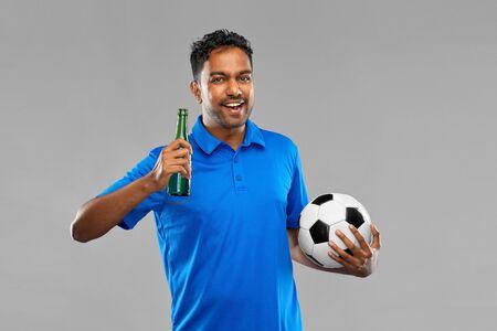 football fan with soccer ball celebrating victory Фото со стока