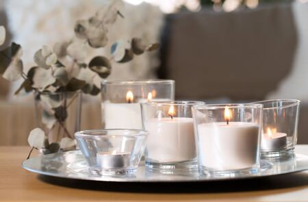 burning fragrance candles on table at cozy home 스톡 콘텐츠
