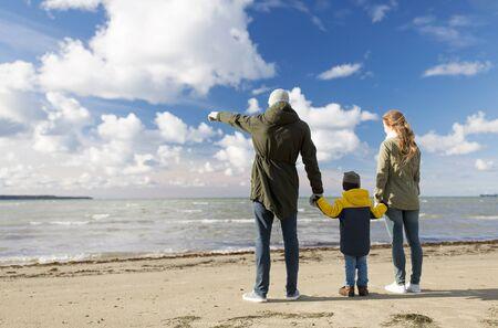 happy family at autumn beach looking at sea