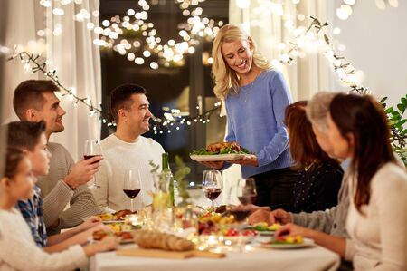 happy family having dinner party at home Stockfoto