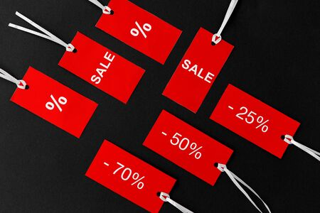 red tags with discount signs on black background Banco de Imagens
