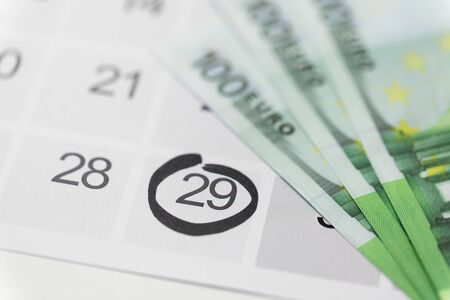 shopping, sale and marketing concept - close up of black friday date on calendar and money Banco de Imagens