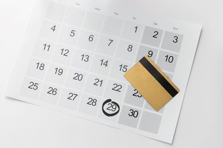 shopping, sale and marketing concept - close up of black friday date on calendar and credit card