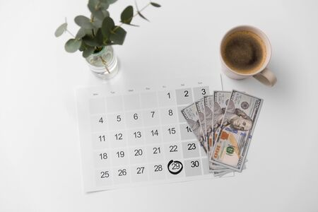 shopping, sale and marketing concept - black friday date on calendar, money and cup of coffee Stock fotó - 131490525