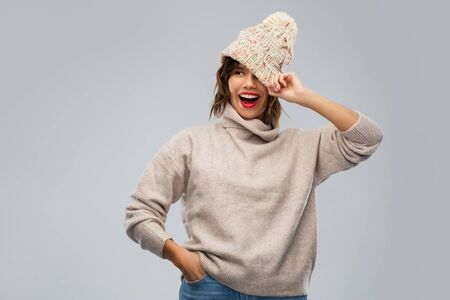 young woman in knitted winter hat and sweater Banco de Imagens