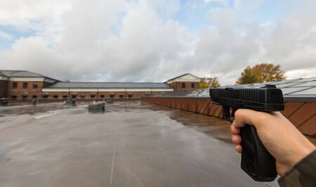 POV of male hands shooting with semi-automatic gun
