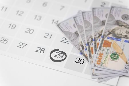 black friday sale date on calendar and money