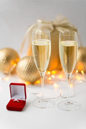 champagne and diamond ring in box on christmas Stock fotó