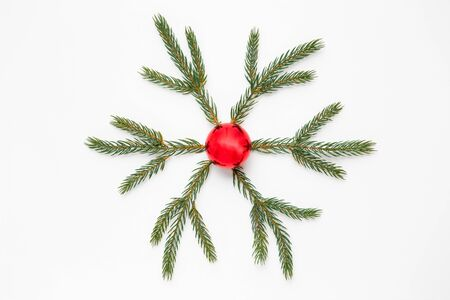 christmas ornament of fir branches and red ball
