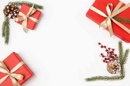 christmas gifts and fir branches with pine cones