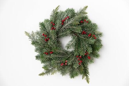 christmas wreath of fir branches with red berries