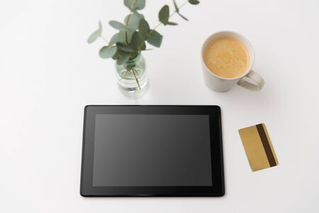 tablet pc computer, credit card and cup of coffee 写真素材