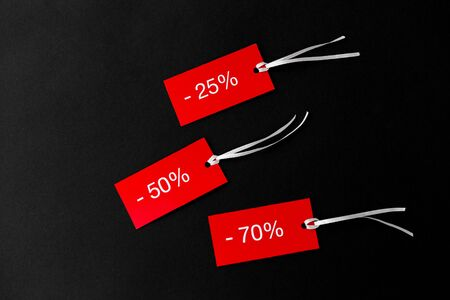 red tags with discount signs on black background 写真素材