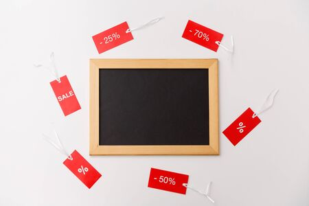 chalk board and red tags with discount signs