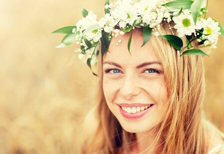 happy woman in wreath of flowers