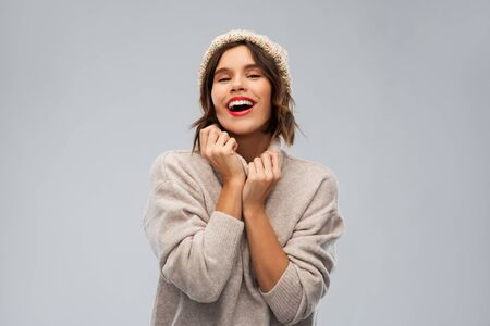 young woman in knitted winter hat and sweater