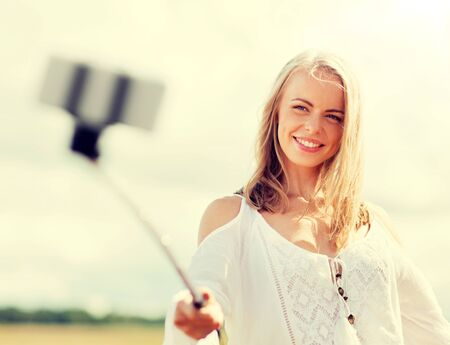 happy young woman taking selfie by smartphone Фото со стока