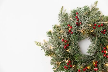 christmas fir wreath with berries and lights
