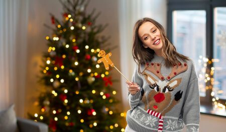 woman in christmas sweater with party accessory